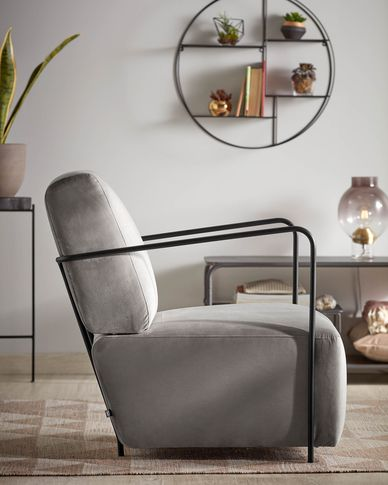 Gamer in grey velvet armchair and metal with black finish
