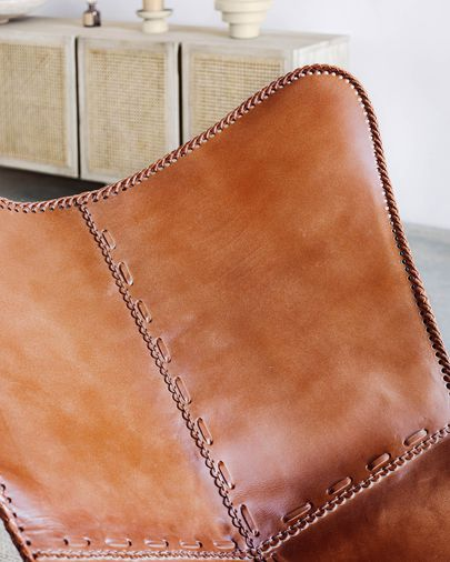 Brown leather Fly armchair