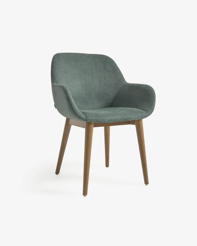 Konna chair in green with solid ash legs
