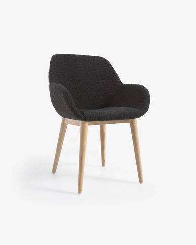 Konna chair in black shearling with solid ash wood legs