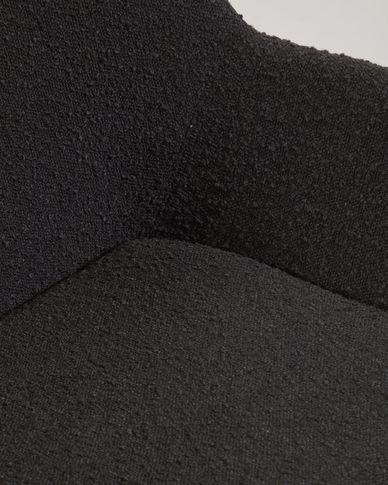 Stoel Konna met zwarte schapenvachtlook en poten van massief essenhout